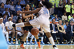 19 November 2014: Oklahoma State's Brittney Martin (22) bounces a pass under North Carolina's Xylina McDaniel (34). The University of North Carolina Tar Heels hosted the Oklahoma State University Cowgirls at Carmichael Arena in Chapel Hill, North Carolina in a 2014-15 NCAA Division I Women's Basketball game. UNC won the game 79-77.