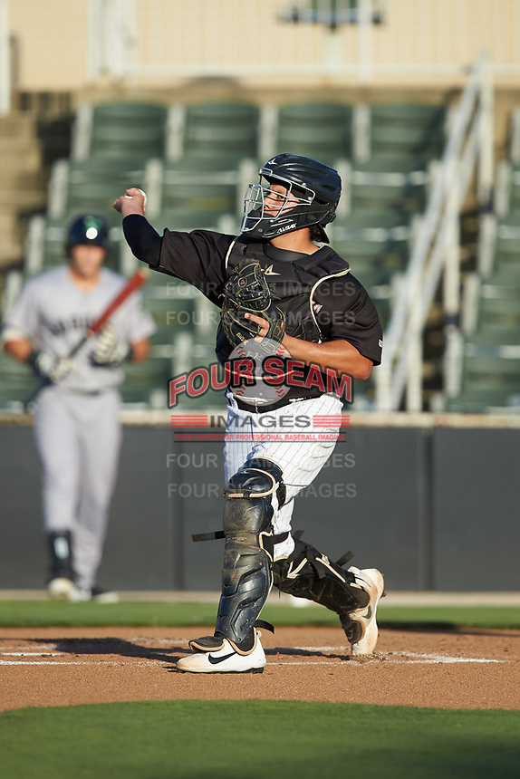 Kannapolis Intimidators catcher Jhoandro Alfaro (14) makes a throw to third base against the Augusta GreenJackets at Kannapolis Intimidators Stadium on June 21, 2019 in Kannapolis, North Carolina. The Intimidators defeated the GreenJackets 6-1. (Brian Westerholt/Four Seam Images)