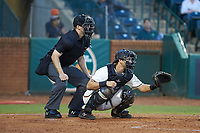 Greensboro Grasshoppers catcher Zac Susi (45) sets a target as home plate umpire Tanner Moore looks on during the game against the Hagerstown Suns at First National Bank Field on April 6, 2019 in Greensboro, North Carolina. The Suns defeated the Grasshoppers 6-5. (Brian Westerholt/Four Seam Images)