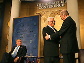 President George W. Bush looks on  as  Israeli Prime Minister Ehud Olmert  and Palestinian Authority President Mahmoud Abbas shake hands  at the .Middle East Peace Conference  at the U. S Naval Academy in Annapolis, Maryland on November 27, 2007.Agency pool photo by Dennis Brack/Black Star