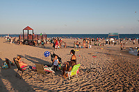 People enjoy the sun on Coney Island Beach in Brooklyn, New York, Sunday July 31, 2011.  Groomed and replenished on a regular basis by the city, Coney Island beach is 4km long and open to all without restriction, and there is no charge for use.