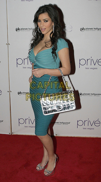 KIM KARDASHIAN.Kim Kardashian hosts an evening at Prive' Night Club in the Planet Hollywood Hotel and Casino with special guest Reggie Bush, Las Vegas, Nevada, USA..January 26th, 2008.full length green blue teal dress striped stripes silver metallic bag purse shoes .CAP/ADM/MJT.©MJT/AdMedia/Capital Pictures. *** Local Caption *** .