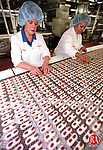 NAUGATUCK, CT 10/05/98--1005CA07.tif  (left to right) Barbara Coelho from Naugatuck and Edith Gooch from Waterbury, both combined with 64 years on the job at Peter Paul Hershey, inspect the alignment of the almonds in a Almond Joy candy bar, at the Naugatuck plant. --CRAIG AMBROSIO staff  / STAND ALONE PHOTO  (Filed in Scans/Scan-In)