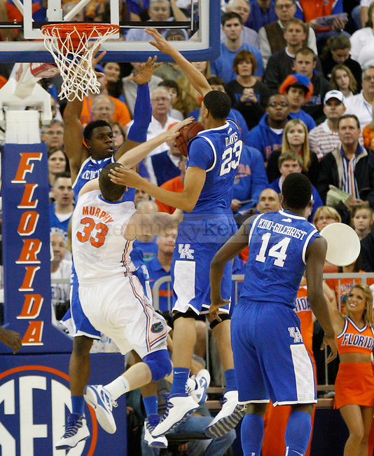 UK forwards Terrence Jones and Anthony Davis attempt to Florida's Eric Murphy's shot during the first half of the University of Kentucky's men basketball game against University of Florida 3/4/12 at the O'Connell Center in Gainesville, Fl. Photo by Quianna Lige | Staff