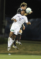 Carey Talley #8 of D.C. United  in an aerial battle with Sheanon Williams #20 of the Harrisburg City Islanders during a US Open Cup match at the Maryland Soccerplex on July 21 2010, in Boyds, Maryland. United won 2-0.