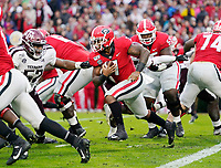 ATHENS, GA - NOVEMBER 23: D'Andre Swift #7 of the Georgia Bulldogs makes a run from the goal line during a game between Texas A