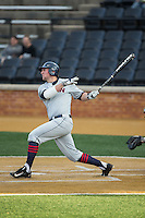 Blake Davey (27) of the UConn Huskies follows through on his swing against the Wake Forest Demon Deacons at Wake Forest Baseball Park on March 17, 2015 in Winston-Salem, North Carolina.  The Demon Deacons defeated the Huskies 6-2.  (Brian Westerholt/Four Seam Images)