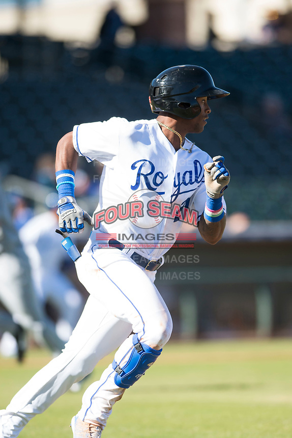 Surprise Saguaros center fielder Nick Heath (21), of the Kansas City Royals organization, runs to first base during an Arizona Fall League game against the Glendale Desert Dogs at Surprise Stadium on November 13, 2018 in Surprise, Arizona. Surprise defeated Glendale 9-2. (Zachary Lucy/Four Seam Images)