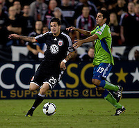 DC United forward (25) Santino Quaranta is taken down by Seattle Sounders defender (19) Leonardo Gonzalez during the Lamar Hunt U.S. Open Cup at RFK Stadium in Washington, DC.  The Seattle Sounders defeated DC United, 2-1.