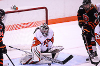 RIT's goaltender Laura Chamberlain (35) makes a save as Princeton University Molly Contini (9) looks for the open rebound. Princeton leads the game 0-1 after the first period at Ritter Arena in Rochester, New York on October 19, 2012