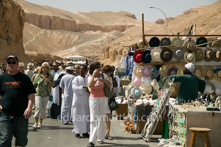 Tourists at the entrance of the Valley of the Kings. It's believed the government intends to create something similar at the Valley of the Nobles, as soon as the Qurna village is cleared from its inhabitants and their houses. The current informal structure through which villagers sell their handcraft to tourists is expected to be substituted by accredited stalls such as these. .Luxor, Egypt..Photo: Eduardo Martino