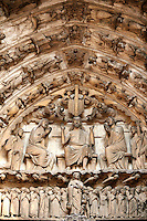 South Porch, Right Portal, Tympanum- General View.This portal is dedicated to the Confessors. Cathedral of Chartres, France. Tympanum and Lintel: Miracles by two very popular saints, Martin and Nicholas, are shown on the tympanum and lintel. Both saints have figures on the jambs below and several windows in the interior lower level and clerestory..On the left is the Miracle of Martin's cloak. In the lower left panel, Martin, a young Roman stationed in Amiens, met a beggar at the city gate one cold day. Moved by the man's suffering, Martin cut his cloak in half and gave him one of the pieces. In the upper left panel, Martin is shown sleeping. His dream is shown on the tympanum; Christ appears wearing the piece of the cloak he gave to the beggar, who had really been Christ..On the right are miracles of Nicholas. In the bottom panel, Nicholas anonymously gives dowries to three indigent girls. On the upper right, pilgrims at Nicholas's tomb, which supposedly gave off a miraculous healing fluid. .Archivolts: .On the lower register of archivolts are miracles of Gilles, including the Mass of St. Gilles (right). The other archivolts show various Confessors.A UNESCO World Heritage Site.