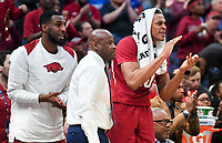 NWA Democrat-Gazette/CHARLIE KAIJO Arkansas Razorbacks forward Arlando Cook (5), head coach Mike Anderson and forward Daniel Gafford (10) react during the Southeastern Conference Men's Basketball Tournament semifinals, Saturday, March 10, 2018 at Scottrade Center in St. Louis, Mo. The Tennessee Volunteers knocked off the Arkansas Razorbacks 84-66
