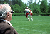 Washington Redskins owner Jack Kent Cooke watches as his team works out during their mini-camp at Redskins Park in Herndon, Virginia during May, 1986.<br /> Credit: Arnold Sachs / CNP