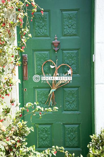 Heart shaped decoration on door in Norwich during Coronavirus lockdown, UK May 2020