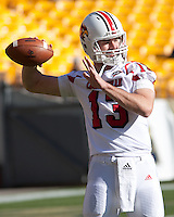 Louisville quarterback Justin Burke. The Pitt Panthers defeated the Louisville Cardinals 20-3 at Heinz Field, Pittsburgh Pennsylvania on October 30, 2010.