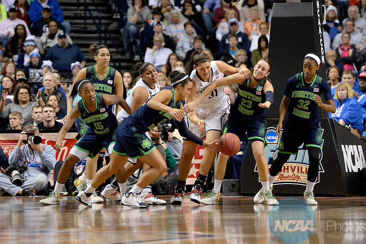 08 APR 2014:  Stefanie Dolson (31) of the University of Connecticut battlea Kayla McBride (21) and Michaela Mabrey (23) of Notre Dame University for a loose ball during the Division I Women's Basketball Championship held at Bridgestone Arena in Nashville, TN.  Connecticut defeated Notre Dame 78-63 for the national title.  Jamie Schwaberow/NCAA Photos