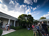 United States President Barack Obama (right) listens as Bob Bergdahl (center) makes a statement and Jani Bergdahl (left) looks on regarding the release of their son U.S. Army Sergeant Bowe Bergdahl by the Taliban, Saturday May 31, 2014, in the Rose Garden at the White House in Washington, D.C.<br /> Credit: John Harrington / Pool via CNP