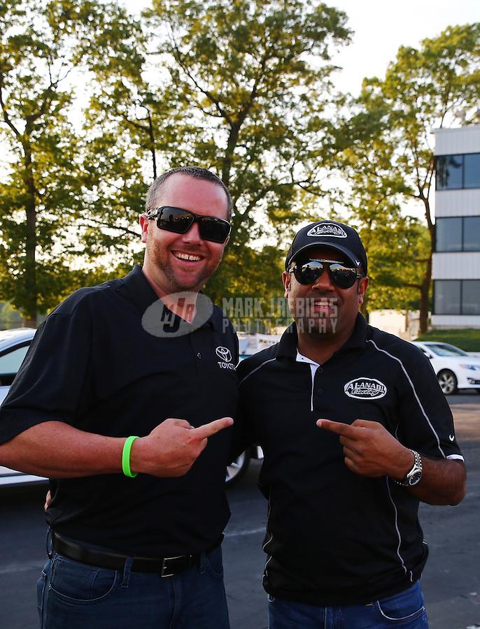 May 30, 2013; Englishtown, NJ, USA: NHRA top fuel dragster drivers Shawn Langdon (left) and Khalid Albalooshi at Raceway Park. Mandatory Credit: Mark J. Rebilas-