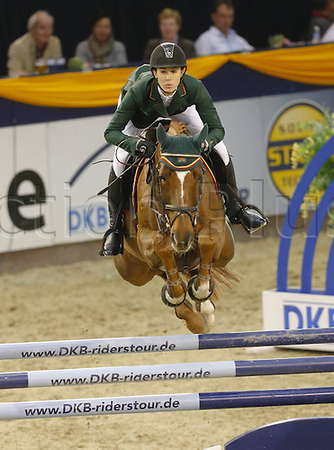 20.10.2013 Hannover Germany. Alexandra Fricker [SUI] and Paille in action during The 2013 German Classics International Horse Show
