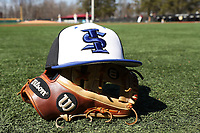 ELON, NC - MARCH 1: An Indiana State baseball hat on a glove during a game between Indiana State and Elon at Walter C. Latham Park on March 1, 2020 in Elon, North Carolina.