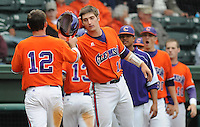 May 11, 2009: Outfielder Wilson Boyd (12) of the Clemson Tigers is congratulated after scoring a run in a game against the Furman Paladins at Fluor Field at the West End in Greenville, S.C. Photo by: Tom Priddy/Four Seam Images