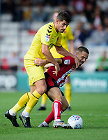 Lincoln City's Jack Payne shields the ball from Fleetwood Town's Ched Evans<br /> <br /> Photographer Andrew Vaughan/CameraSport<br /> <br /> The EFL Sky Bet League One - Lincoln City v Fleetwood Town - Saturday 31st August 2019 - Sincil Bank - Lincoln<br /> <br /> World Copyright © 2019 CameraSport. All rights reserved. 43 Linden Ave. Countesthorpe. Leicester. England. LE8 5PG - Tel: +44 (0) 116 277 4147 - admin@camerasport.com - www.camerasport.com