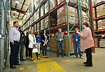 Linda Keenan (R) Director of Development for the Food Bank of Monmouth & Ocean, give a facility tour to Jersey Central Power & Light Employees (L to R) Kieran Tintle, William Kwasnicki, Toni Reaves, Courtney Donaldson, Elaine Vincent, Melissa Todero, John Mahon & William Puchik after JCP&L presented a check for $6,528.00 to The Food Bank of Monmouth & Ocean Counties in Neptune, NJ on April 13, 2017.
