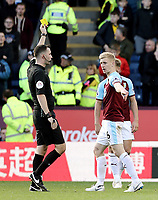 Burnley's Ben Mee is shown a yellow card by Referee Christopher Kavanagh for his foul on Huddersfield Town's Philip Billing (grounded)<br /> <br /> Photographer Rich Linley/CameraSport<br /> <br /> The Premier League - Burnley v Huddersfield Town - Saturday 6th October 2018 - Turf Moor - Burnley<br /> <br /> World Copyright &copy; 2018 CameraSport. All rights reserved. 43 Linden Ave. Countesthorpe. Leicester. England. LE8 5PG - Tel: +44 (0) 116 277 4147 - admin@camerasport.com - www.camerasport.com