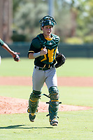 Oakland Athletics catcher Cesare Astorri (12) jogs back to the plate after a mound visit during an Instructional League game against the Los Angeles Dodgers at Camelback Ranch on September 27, 2018 in Glendale, Arizona. (Zachary Lucy/Four Seam Images)