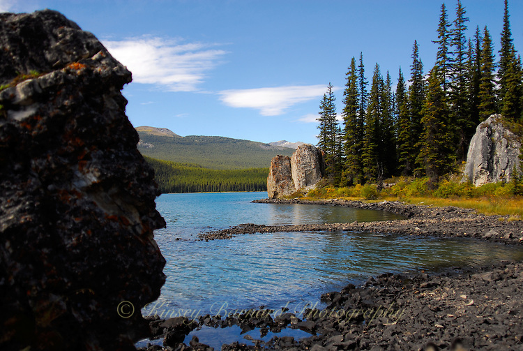 Indain head natural stone sculpture stands guard on the Maligne Lake shore.