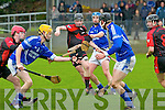 AIB Munster Club Junior Hurling Championship Quarter Final which took place on Sunday at 2pm in Kevin Long Park, Feenagh.  Referee Paul Foley of Waterford.  Feenagh-Kilmeedy VS Kenmare Shamrocks.  <br /> <br /> Diarmuid Coleman (10) of Feenagh./Kilmeedy hand passing the ball to his team mate Gerard O'Gorman (9) while being challenged by Micheal O'Sullivan (7) of Kenmare Shamrocks. In the background you have Alan O'Leary (6) of Kenmare Shamrocks getting his jersey pulled by Peter Irwin (11) of Feenagh/Kilmeedy. Also Pictured is Colm O'Sullivan (8) of Kenmare.
