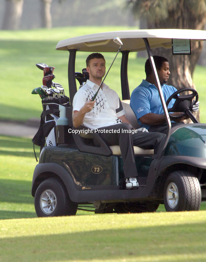 12-3-08.WED .JUSTIN TIMBERLAKE GOLFING AT LAKESIDE GOLF COURSE IN BURBANK CALIFORNIA WITH A FRIEND Alfonso Ribeiro...ABILITYFILMS@YAHOO.COM.805-427-3519.WWW.ABILITYFILMS.COM.
