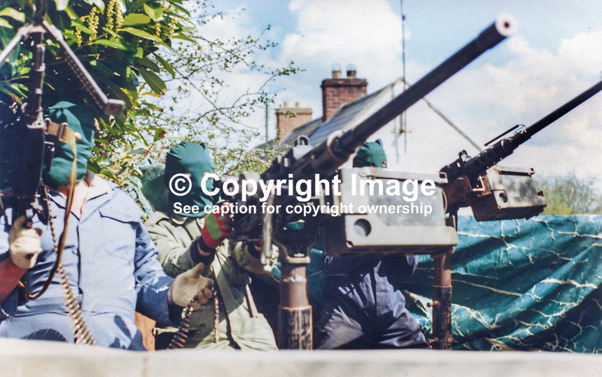 This republican movement press release photograph claims to be of a Provisional IRA border unit on manoeuvres in Co Fermanagh, N Ireland, February 1977.  The volunteers are seen using Browning M2 50mm machine guns. 197702130024f<br /> <br /> Copyright Image distributed by Victor Patterson, 54 Dorchester Park, Belfast, UK, BT9 6RJ<br /> <br /> Tel: +44 28 9066 1296<br /> Mob: +44 7802 353836<br /> Voicemail +44 20 8816 7153<br /> Email: victorpatterson@me.com<br /> <br /> <br /> IMPORTANT: If you wish to use this image or any other of my images please go to www.victorpatterson.com and click on the Terms &amp; Conditions. Then contact me by email or phone with the reference number(s) of the image(s) concerned.