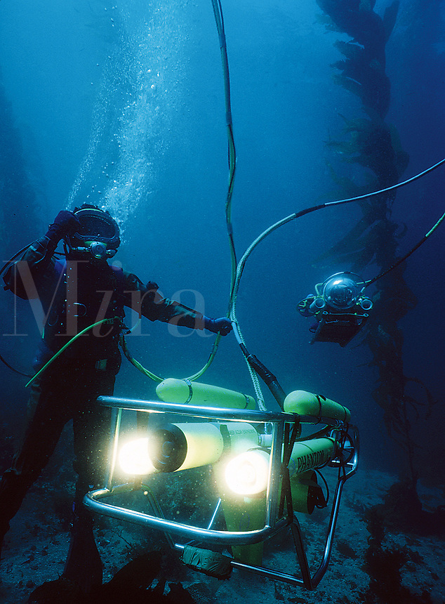 Commercial diver with underwater robotic vehicles (ROV,  remotely operated vehicle), Anacapa Island, CA..