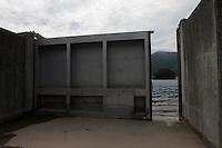 An open sea wall steel gate during reconstruction efforts following the 311 Tohoku Tsunami in Ofunato, Japan  © LAN
