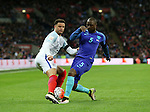 England's Kyle Walker tussles with Netherland's Jetro Willems during the International friendly match at Wembley.  Photo credit should read: David Klein/Sportimage