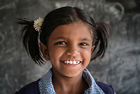 Local residents pose for a portrait at the government school in Ambedkar Nagar in Telangana, India.