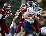 MADISON, SD - SEPTEMBER 11:  Jordan Lueth #31 from West Central is corralled by Marcus VandenBosch #32, Riley Janke #31 and Jaxon Janke #6 from Madison in the first half of their game Friday night in Madison. (Photo by Dave Eggen/Inertia)