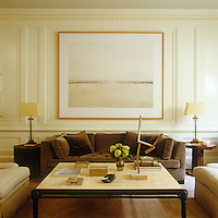 An Elger Esser photograph hangs above a custom-made sofa in the living room; the sculpture is by Joel Shapiro