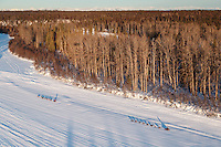 Teams run down the Yentna River a few hours after leaving the Restart of the 2016 Iditarod in Willow, Alaska.  March 06, 2016.