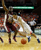 Virginia guard Malcolm Brogdon (15) drives past Florida State guard Montay Brandon (32) during the second half of an NCAA basketball game Saturday Jan. 18, 2014 in Charlottesville, VA. Virginia defeated Florida State 78-66. (AP Photo/Andrew Shurtleff)