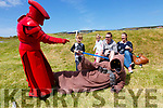 Austin Lynch from Tralee gets instruction from a Praetorian Guard on the use of a Lightsaber at the May the 4th be with you festival in Valentia on Sunday also pictured a Jawa and back l-r; Mckenzie, Dave & Aisling Lynch.