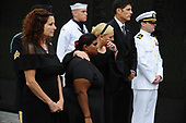 Bridget McCain, and Meghan McCain hug while U.S. Secretary of Defense James Mattis, General John Kelly, White House Chief of Staff and Cindy McCain, wife of late Senator John McCain, lay a ceremonial wreath honoring all whose lives were lost during the Vietnam War at the Vietnam Veterans Memorial in Washington, U.S., September 1, 2018.  <br /> Credit: Mary F. Calvert / Pool via CNP
