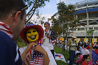 Andy McNeill of Atlanta, Georgia talks with a Korean friend who had her face painted before the United States National Team match against Poland at Daejon World Cup Stadium, in Daejon, South Korea.  Poland defeated the United States 3-1. However, with South Korea's 1-0 victory over Portugal, the USA advanced to the second round of the World Cup.