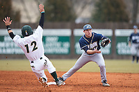 Dom Iero (15) of the Akron Zips gets the force out as Luke Gibbs (12) of the Charlotte 49ers slides into second base of the Akron Zips at Hayes Stadium on February 22, 2015 in Charlotte, North Carolina.  The Zips defeated the 49ers 5-4.  (Brian Westerholt/Four Seam Images)