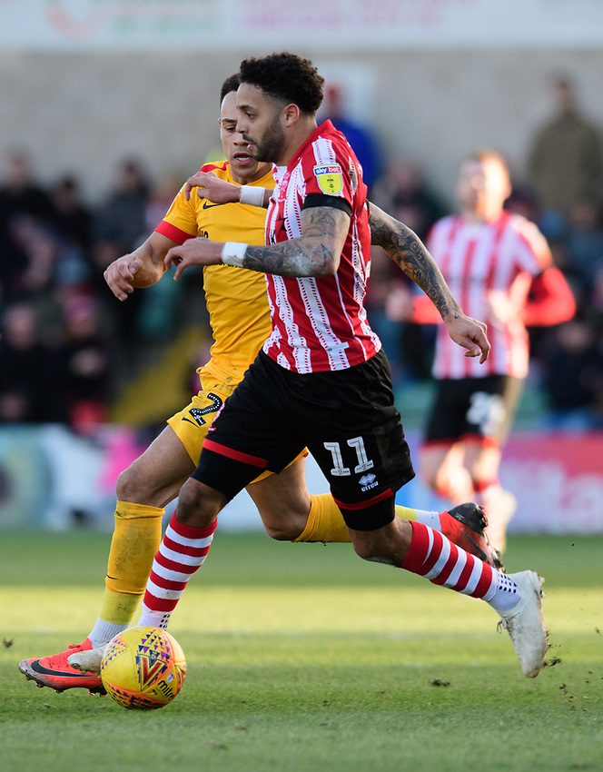 Lincoln City's Bruno Andrade vies for possession with Northampton Town's Shay Facey<br /> <br /> Photographer Chris Vaughan/CameraSport<br /> <br /> The EFL Sky Bet League Two - Lincoln City v Northampton Town - Saturday 9th February 2019 - Sincil Bank - Lincoln<br /> <br /> World Copyright © 2019 CameraSport. All rights reserved. 43 Linden Ave. Countesthorpe. Leicester. England. LE8 5PG - Tel: +44 (0) 116 277 4147 - admin@camerasport.com - www.camerasport.com