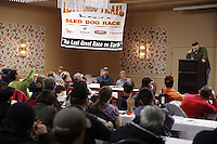 Race Marshal Mark Nordman talks over the rules with mushers during the mandatory musher meeting at the Millenium hotel two days prior to the start of Iditarod 2013...Photo (C) Jeff Schultz/IditarodPhotos.com  Do not reproduce without permission.