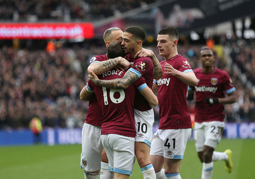 West Ham United's Mark Noble celebrates scoring his side's first goal with Marko Arnautovic, Manuel Lanzini and Declan Rice<br /> <br /> Photographer Rob Newell/CameraSport<br /> <br /> The Premier League - West Ham United v Huddersfield Town - Saturday 16th March 2019 - London Stadium - London<br /> <br /> World Copyright © 2019 CameraSport. All rights reserved. 43 Linden Ave. Countesthorpe. Leicester. England. LE8 5PG - Tel: +44 (0) 116 277 4147 - admin@camerasport.com - www.camerasport.com