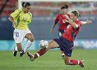 26 August 2004: Abby Wambach tries to tackle the ball against Marta of Brazil during the Gold Medal game at Karaiskaki Stadium in Athens, Greece.   USA defeated Brazil, 2-1 in overtime.   Credit: Michael Pimentel / ISI.